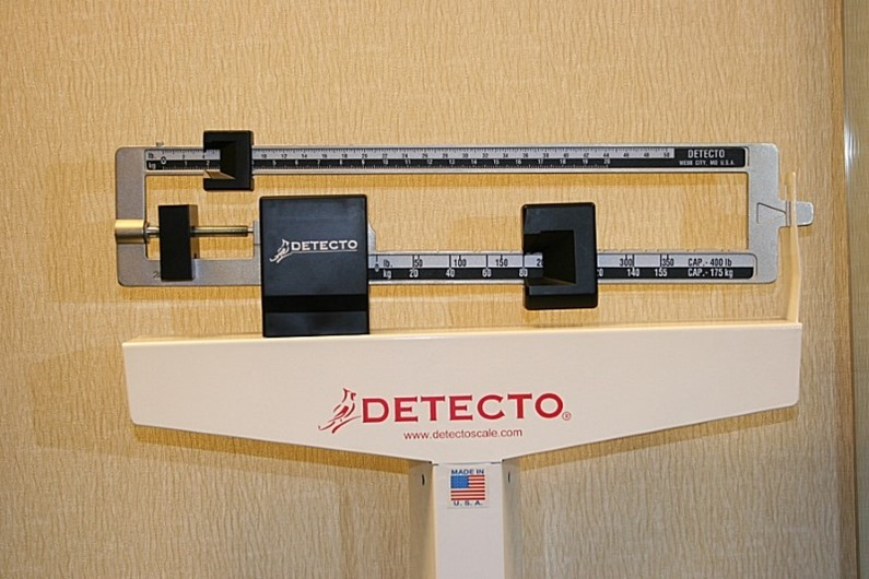 doctor weighing scales